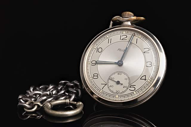 pocket watch worn on the left hand