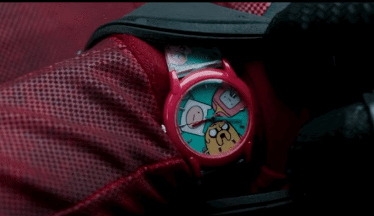 Deadpool showing his watch